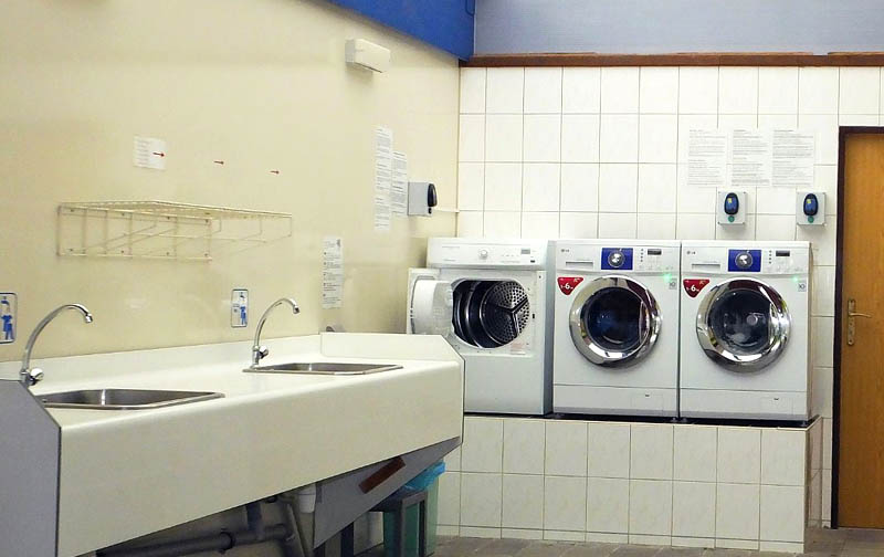 Hand washing of clothes, washing machines and dryers