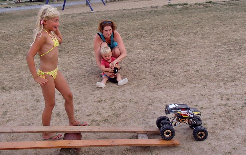 RC cars riding over obstacles